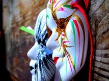 Two masquerade masks. Two beautiful Venetian masquerade masks royalty free stock photos