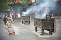 Praying in Lama temple, Beijing stock images