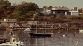 Two masted boat in port stock video footage