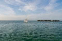 Two Masted Sailboat on Calm Bay Royalty Free Stock Images