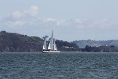 Two Masted Sailboat Under Sail On Bay Royalty Free Stock Photo