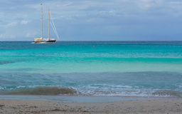 Two masted sailing boat on turquoise sea Royalty Free Stock Image
