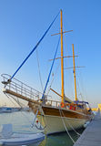 Two-masted sailing ship anchored in the harbor Royalty Free Stock Photo