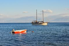 Two Masted Sailing Yacht Anchored in Bay, Greece. A traditional two masted sailing yacht, or boat, anchored for the night in the protected waters of a Gulf of Royalty Free Stock Images