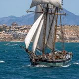 Two masted Schooner Tall Ship Full Sail. Sailing in Alicante waters Mediterranean Royalty Free Stock Photos