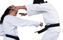 Two Master Black Belt TaeKwonDo teacher student stock photo