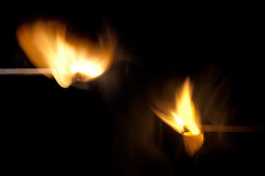 Two matches burning. Two matches at the moment of ignition Stock Image