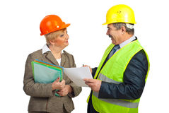 Two mature architects in funny conversation Royalty Free Stock Image