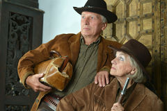 Two mature bandits with guns Royalty Free Stock Image