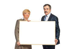 Two mature business people hold blank banner Stock Image