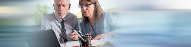 Two mature business people working together Royalty Free Stock Image