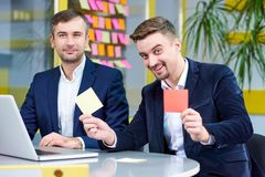 Two mature caucasian male having fun in the office stock photos