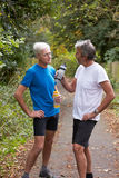 Two Mature Male Joggers Taking Break Whilst On Run.  Stock Image