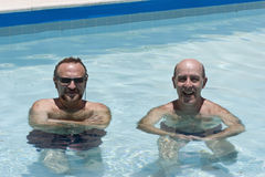 Two mature men enjoing pool Stock Image