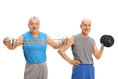 Two mature men exercising with resistance band and dumbbell. Two mature men exercising with a resistance band and a dumbbell isolated on white background Stock Photography