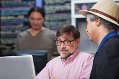 Two Mature Men Talking Stock Photo