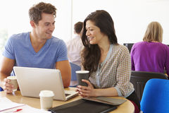 Two Mature Students Working Together Using Laptop Royalty Free Stock Photography