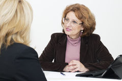 Two mature woman in business Royalty Free Stock Photography