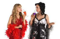 Two mature woman drink color poison alcohol Stock Photo