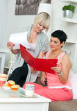 Two mature woman friends working at home Stock Photography