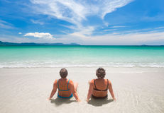 Two mature woman in swimwear  relaxing on the beach. Mature women in swimwear  relaxing on the beach. Relaxed senior caucasian women outdoors Royalty Free Stock Photos