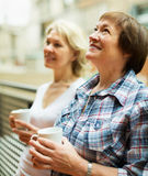 Two mature women drinking tea Stock Photo