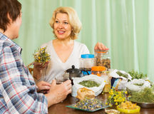 Two mature women with  herbs Royalty Free Stock Images