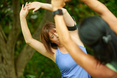 Two mature women keeping fit and streching before jogging Royalty Free Stock Photos