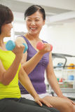Two mature women lifting weights in the gym Stock Image