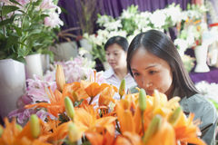 Two Mature women Looking At Flowers In Flower Shop Royalty Free Stock Photos