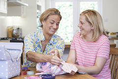 Two Mature Women Sewing Quilt Together. Two Mature Women Sewing Quilt Royalty Free Stock Photography
