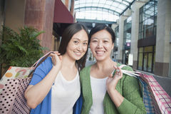 Two Mature Women In Shopping Mall Stock Photo