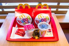 Two Mcdonalds happy meal boxes with Lipton tea, Coca-Cola, tomato ketchup and sugar. Gdansk, Poland - February 21, 2018: Two Mcdonalds happy meal boxes with Stock Image