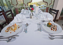 Two meals in an a la carte restaurant Stock Images