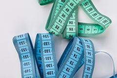 Two measuring tapes, white background. Colorful measuring objects. Measuring for your design Royalty Free Stock Photo
