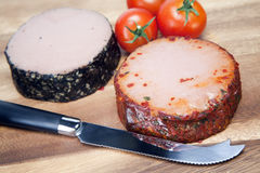 Two meat pastes, special knife and tomato Stock Photos