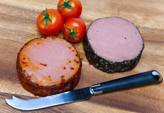 Two meat pastes, special knife and tomato.Still-life i Stock Image