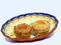 Two meat-pies. A meat-pie chicken on a traditional porcelain Stock Photo