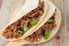 Two meat tacos with black beans garnished with cilantro Stock Photos