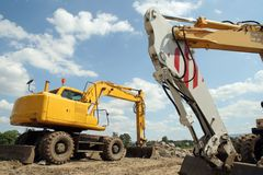Two mechanical shovels. On building site Royalty Free Stock Image