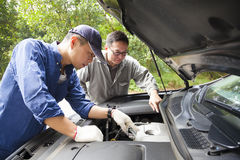 Two Mechanics fixing the car stock images