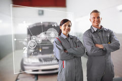 Two mechanics standing in front of a futuristic interface. In a garage stock illustration
