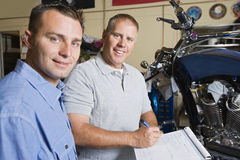 Two Mechanics At Work Royalty Free Stock Photography