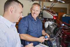 Two Mechanics At Work Stock Photography