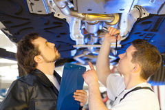 Two mechanics at work. Stock Images