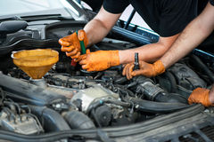 Two mechanics working on a vehicle Stock Image