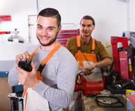 Two mechanics in workshop Stock Photos