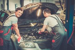 Two mechanics in a workshop Stock Photo