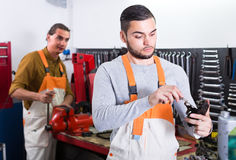 Two mechanics in workshop Stock Images