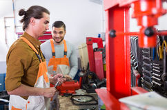 Two mechanics in workshop Royalty Free Stock Photos